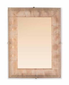 RENÉ LALIQUE (1860-1945) CADRE MIROIR 'CRANS', LE MODÈLE CRÉÉ LE 29 MARS 1929, NON REPRIS APRÈS 1947 En verre moulé pressé patiné à fond de miroir teinté (deux petits éclats aux angles arrière) 63 x 47 cm. (24¾ x 18½ in.)
