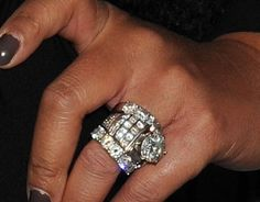 Wendy Williams' wedding ring, and & bands!! Says the center stone was a 3 carrot but on her 7th Anniversary her husband ungraded it to a size 7 and they added another band to it! I love it !