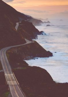 Monterey, California. Seems like a perfect road to drive on on a motorcycle or just a car with all the windows down and the music blasting! Hair and hands going  everywhere- sash w