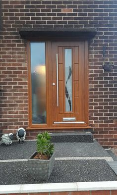 A stunning Golden Oak Vermont Ultimate Rockdoor recently fitted with Haze glass design. #Rockdoor #HomeImprovement