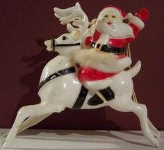Vintage Hard Plastic Santa on Deer by riptheskull, via Flickr