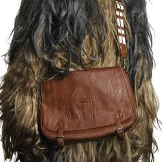 """Crafted of faux leather, it is the perfect size for toting your 11"""" MacBook Air, a netbook, or a tablet as well as any other items you need on your daily adventures. The bandolier style shoulder strap is adjustable for heights from Ewok to Wookiee."""