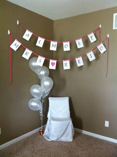 Simple and beautiful... Corner for bride-to-be to sit while opening gifts. Great background for pictures that you know will happen at a bridal shower...