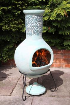 Extra large sized clay chimenea in a sage green colour. The chimenea comes complete with steel stand and rain lid, the lid is only for use when the chimenea is not lit.This patio heater is made from clay and therefore does not need large fires, clay is extremely efficient and heats up quickly whilst retaining the heat for a long time afterwards.These chimeneas are hand made and hand painted and therefore each chimenea is unique therefore colours, patterns and shape may vary slightly.