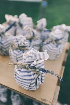 Rough cut, striped fabric - paired with a sprig of lavender - cloth wrapping for the win!