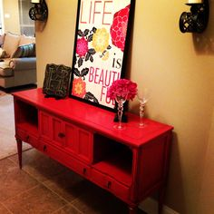 Bright red shabby chic table in foyer.