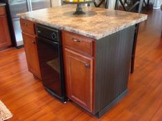 I am thinking of doing this on our peninsula...I don't have a dishwasher on the other side, just cabinets.  I found this post AFTER I came up with this idea!  Very cool to see someone has done it and how it looks!