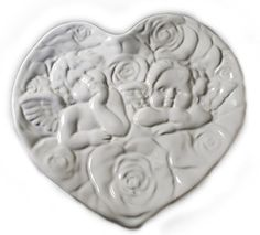 White Ceramic Heart Shaped Dish with Raised Design of Raphael's Angels World Bazaar Inc. http://www.amazon.com/dp/B01A6226TY/ref=cm_sw_r_pi_dp_yTXLwb1NHK91Z