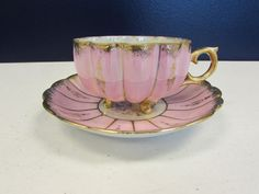 Up for Auction... Gorgeous and Elegant Iridescent Scalloped Pink and White Teacup and Saucer by Royal Sealy China. Vintage Luster ware Made in Japan 3 Footed Tea Cup with Gold Gilding on the feet, handle, rim and rim of saucer.