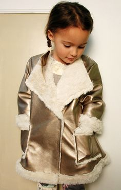aw14: From Mack & Co.'s Magpie Collection. The metallic gold coat lined in faux fur. www.mackandco.com