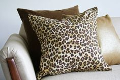 I Love using a couple of Leopard Pillows to sass up a family/living room! Monroe pillows.