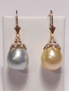 i think i love these.  South Sea golden,gray-blue pearl (asymmetrical) earrings,diamonds,solid 14k YG