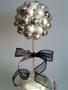 New Years Craft: Festive Ball Topiary. Use holiday ornaments to make this gorgeous topiary for your New Year Party or display it through the year.
