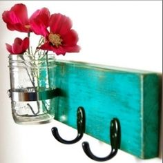 Repurpose old materials and vintage finds into key holders: piece of wood, paint, two hooks & mason jar
