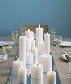 White candles on a mirror