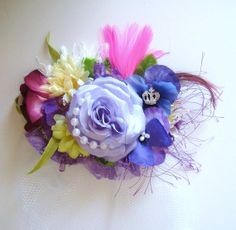 Custom colors, accents and many flowers to choose from. Floral hairpiece. www.DandFT.com