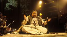 Pakistani musician Nusrat Fateh Ali Khan performs live on stage on the TV show 'Big World Cafe' in February Get premium, high resolution news photos at Getty Images Bollywood Cinema, Bollywood News, Pakistani Music, Nfak Lines, History Of Pakistan, Nusrat Fateh Ali Khan, Classical Music, The Voice, Musica