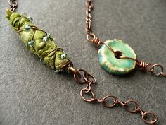 livewire jewelry: GOING SLOW, fabric bead wrapped in beaded wire,  Nice look.