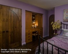 Deep orchid walls and warm honey wood create a petite master suite for this Palo Alto homeowner.  Built in desk rounds out this room!