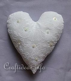 I remember my Mom and Grandma both had fancy lace pin cushions that hung on the wall.