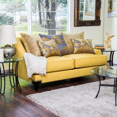 Add luxury right into your living decor, the Visconti loveseat offers swooping arms and a low back to accentuate the matching printed accent pillows. The entire piece is upholstered in soft padded fabric and is available in two upholstery color choices.