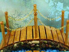 miniature bridge of wood and pebbles