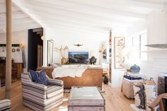 """Jennifer's Rustic & Refined Ranch House """"The sofa placement perfectly divides the great room into two distinct spaces."""""""