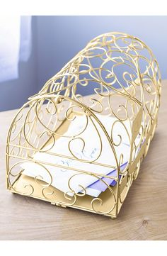 Completing the reception gift table with this ornate goldtone mailbox perfect for storing envelopes, gift cards and other small gifts.