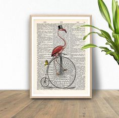 FLAMINGO ON BICYCLE [ART 146]   Our dictionary art prints are a very unique and fun way to style your home. The prints are perfect birthday, wedding and holiday gifts for all people and children.  PLEASE CHOOSE FROM OUR TYPES AND SIZES OF PRINTS: ---------------------------------------------------------------------------------------------------------  1. ORIGINAL ANTIQUARIAN BOOK PRINT – 8 x 10 INCH OR A4 210 x 297 mm (8.3x11.7)  Printed on high quality vintage dictionary paper, english…