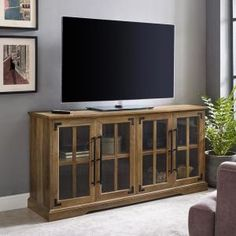 Get the best and essential addition to your home with the help of this durable Welwick Designs Reclaimed Barnwood Farmhouse TV Console for TV's. Farmhouse Tv Stand, Farmhouse Design, Modern Farmhouse, Glass Tv Stand, Media Furniture, Furniture Sale, Rustic Hardware, Tempered Glass Door, Living Room Storage