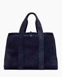 Large signature tote in navy - Transitioning seamlessly from weekend getaway to daily carryall, this soft suede tote was designed with the traveler in mind.