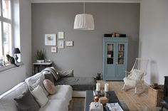 Love this room, the collage on the wall, the simple grey. love.