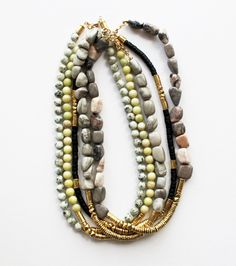 Necklaces in variations of sesame jasper, lemon jade, black coconut, marble pebbles 