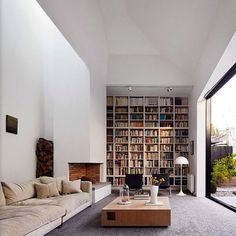 23 Bookcases To Lust Over — & Copy Immediately  #refinery29  http://www.refinery29.com/best-bookcase-decorating-ideas#slide-16  If you have super-high ceilings, you might as well recreate the library from Beauty and the Beast.