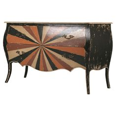 Kashmir Bombe-style wood chest with a scalloped apron and multicolor drawer fronts.  Product: ChestConstruction Material: