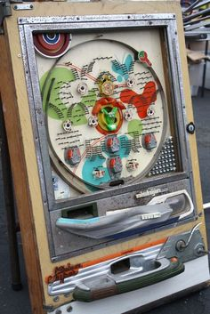 How I loved my Pachinko game when I was a kid! Those little steel balls hurt like heck if you stepped on one though.
