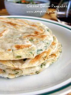 Green Onion Pancakes, Scallion Pancakes, Dim Sum recipe - just made a batch of these for lunch. I added cheese. YUM. :-}