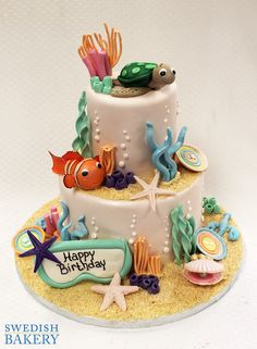 Under the Sea, Fish & Goggles | Two tiered, fondant children's party cake with fondant coral and sea life, and fondant fish, turtle and goggles.