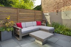 A comfy lounge area for a small backyard garden in Brooklyn. Sofa and table are from West Elm, patio is thermal bluestone, and privacy fencing is horizontal clear cedar for a modern look. Privacy Fences, Fencing, Small Backyard Gardens, Lounge Areas, West Elm, Outdoor Furniture, Outdoor Decor, Design Projects, Landscape Design