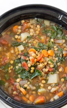 Crock Pot Vegetable Lentil Soup Recipe - This warm and comforting veggie lentil soup is vegan, delicious, and so easy to prepare using your slow cooker. This is a fantastic plant-based meal that will warm your belly and leave you feeling satisfied.
