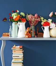 Decorating with flowers is a great way to refresh your home for the season. If fresh flowers aren't for you, you may consider artificial ones. They're perfect if you have little time, are allergic to real blooms or want to be thrifty. Plus they always stay fresh. Mix in special objects for a personalized display.