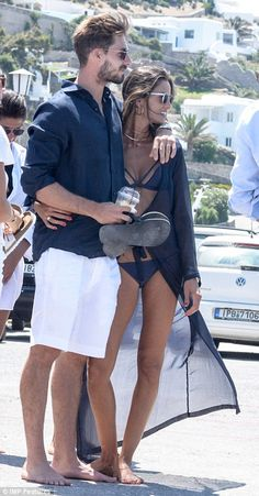 Power couple: Kevin co-ordinated his fiancee's navy ensemble as he sported a matching silk shirt, white board shorts and black flip-flops Summer Dresses Sale, Summer Outfits Men, Men's Beach Outfits, Dress Sale, Italy Fashion, Mens Fashion, Casual Chic Style, Men Casual, Estilo Olivia Palermo