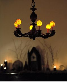 Interior. Inspiring Ghostly Halloween Decoration Mysterious And Unique Chandelier Design Ideas: Appealing Spooktacular Inspiration Halloween Chandelier Design With Small Orange Lighting Pumpkins And Minimal Lighting Ideas ~ wegli