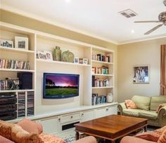 TV wall unit with storage and hidden wires.