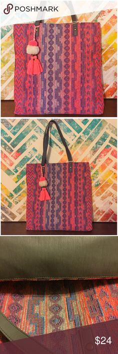 """T-Shirt & Jeans Woven Textile Tote Bag w/ Tassel T-Shirt & Jeans Woven Textile Tote Bag w/ Tassel --- new with tags --- grey man made straps and bottom panel --- straps have 10"""" drop --- 15"""" x 16.5"""" x 3"""" --- beautiful pink, turquoise, and tan colors in a ethnic tribal pattern  ---  thank you for visiting my boutique T-Shirt & Jeans Bags Totes"""