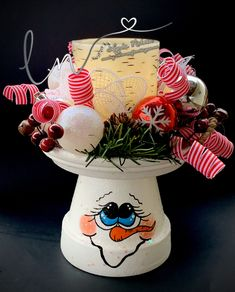 I've decided to keep my adorable hand painted flower pot people photos here. This gives me a place to share the Flower Pots that I've done. Clay Flower Pots, Flower Pot Crafts, Clay Pot Crafts, New Crafts, Cute Crafts, Holiday Crafts, Shell Crafts, Christmas Clay, Christmas Projects