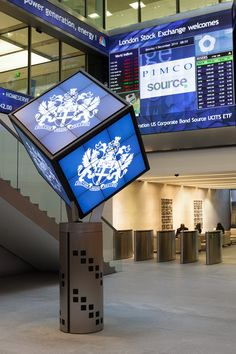 Digital signage in the form of a rotating digital cube situated in the entrance of the London Stock Exchange. It is used as part of the market openings. The Cube was designed, manufactured and installed by 10 Squared.