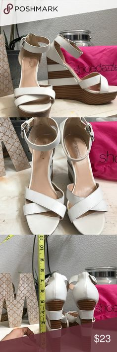 White and brown wedges ✨shoe dazzle white and brown wedges they do need a little bit of cleaning there's a scuff mark on the inner part of left  shoe other than that they can still get ALOT more use ✨make me an offer !! Dust bag included Shoe Dazzle Shoes Wedges