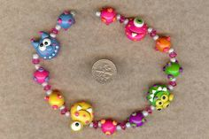 Monster Madness Polymer Clay Beads and Bow Centers, Jewelry, Charm, Pendant, Hair Bow Center. $9.99, via Etsy.