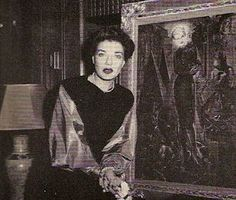 Mona posing with her portrait by Dali, which, when he had painted on some cloths, she grew fond of. Here we see her at the height of her powers, ensconced in her library at Oak Point, just a few years before the big house had to be torn down. The taxes had reached an onerous level, and she had decided to spend the rest of her life in Europe, dividing her time between a magnificent townhouse in Paris, and a Capri retreat that had once been owned by Roman emperors. No wonder Jackie O. envied…